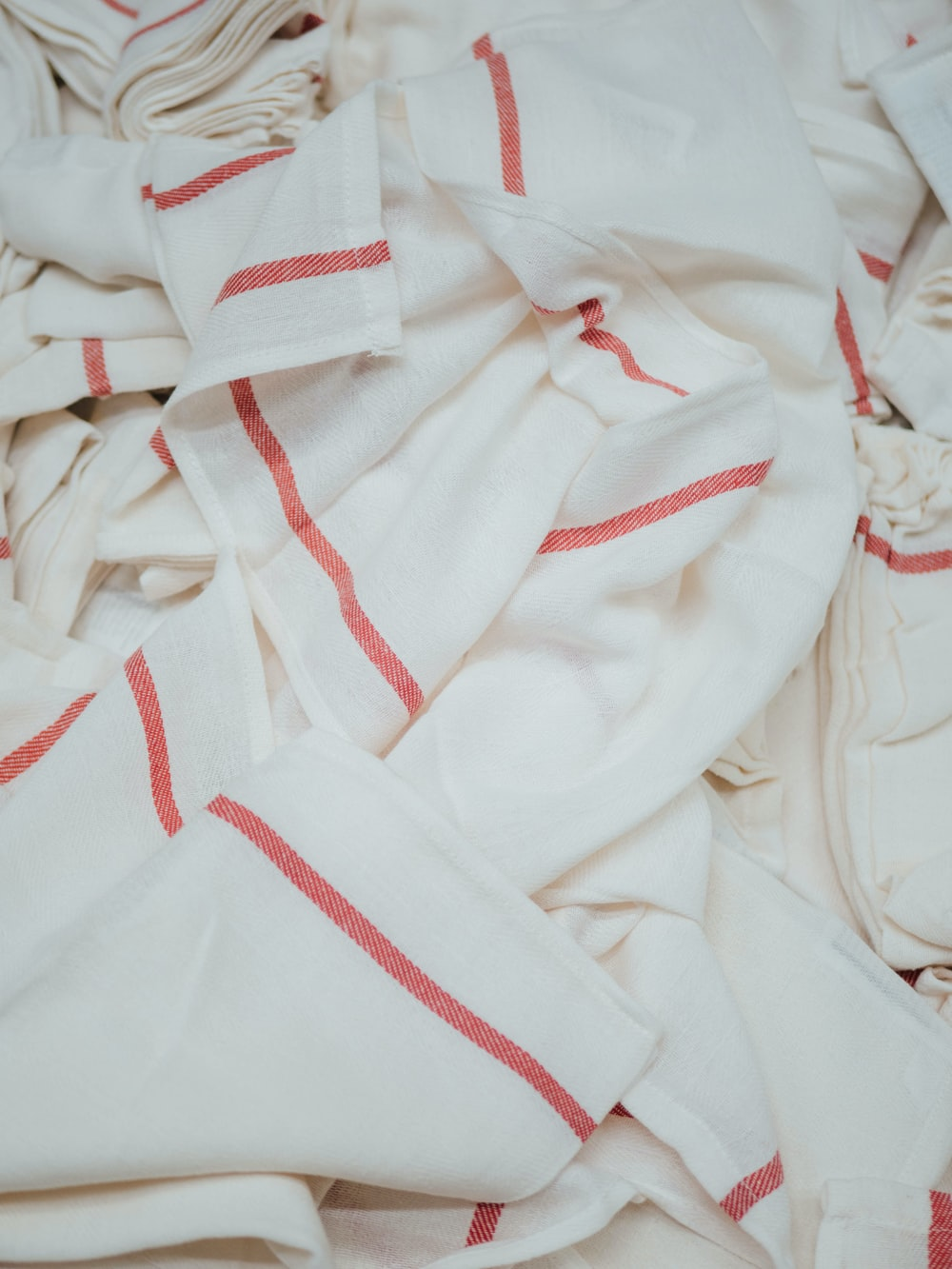 white and red textiles