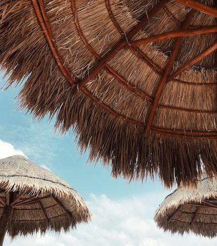 Tiki Huts on Blue Sky