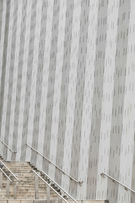 gray staircase near wall