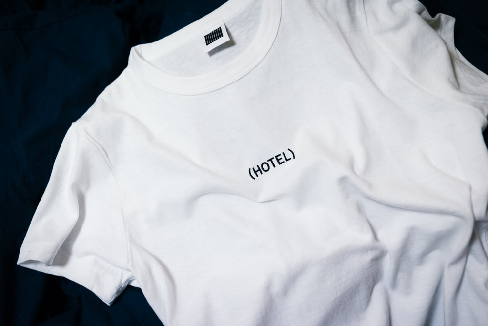 white hotel-printed crew-neck shirt on black surface