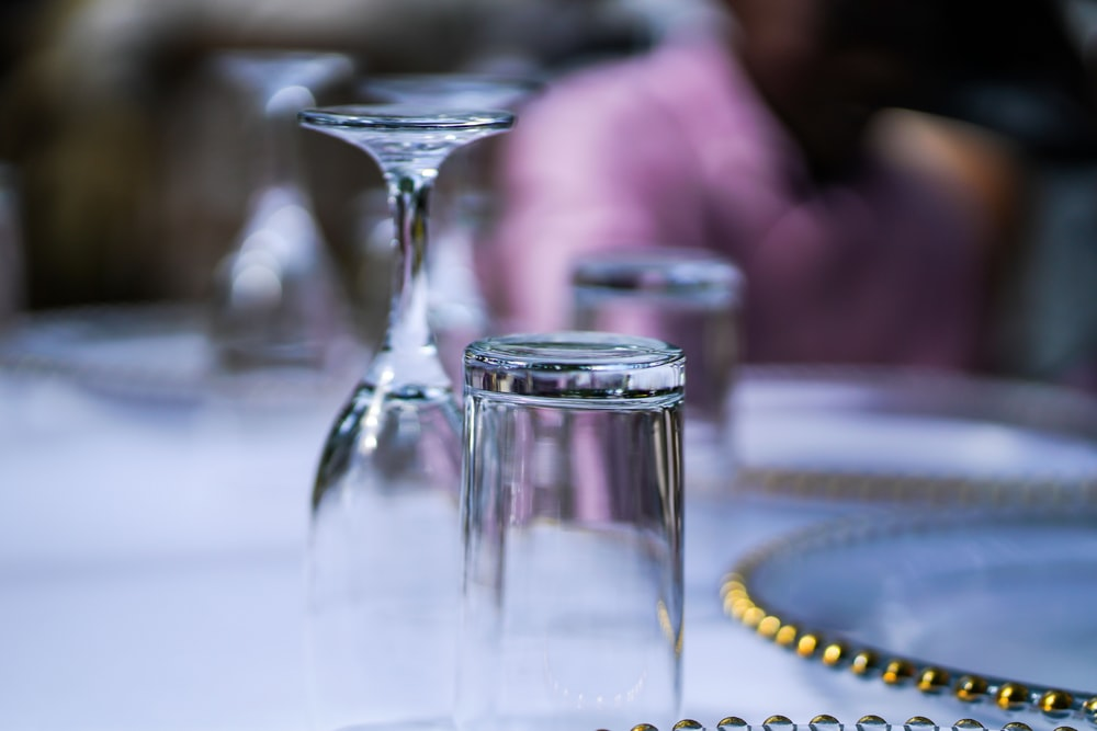 clear flute and highball glasses upside down on table