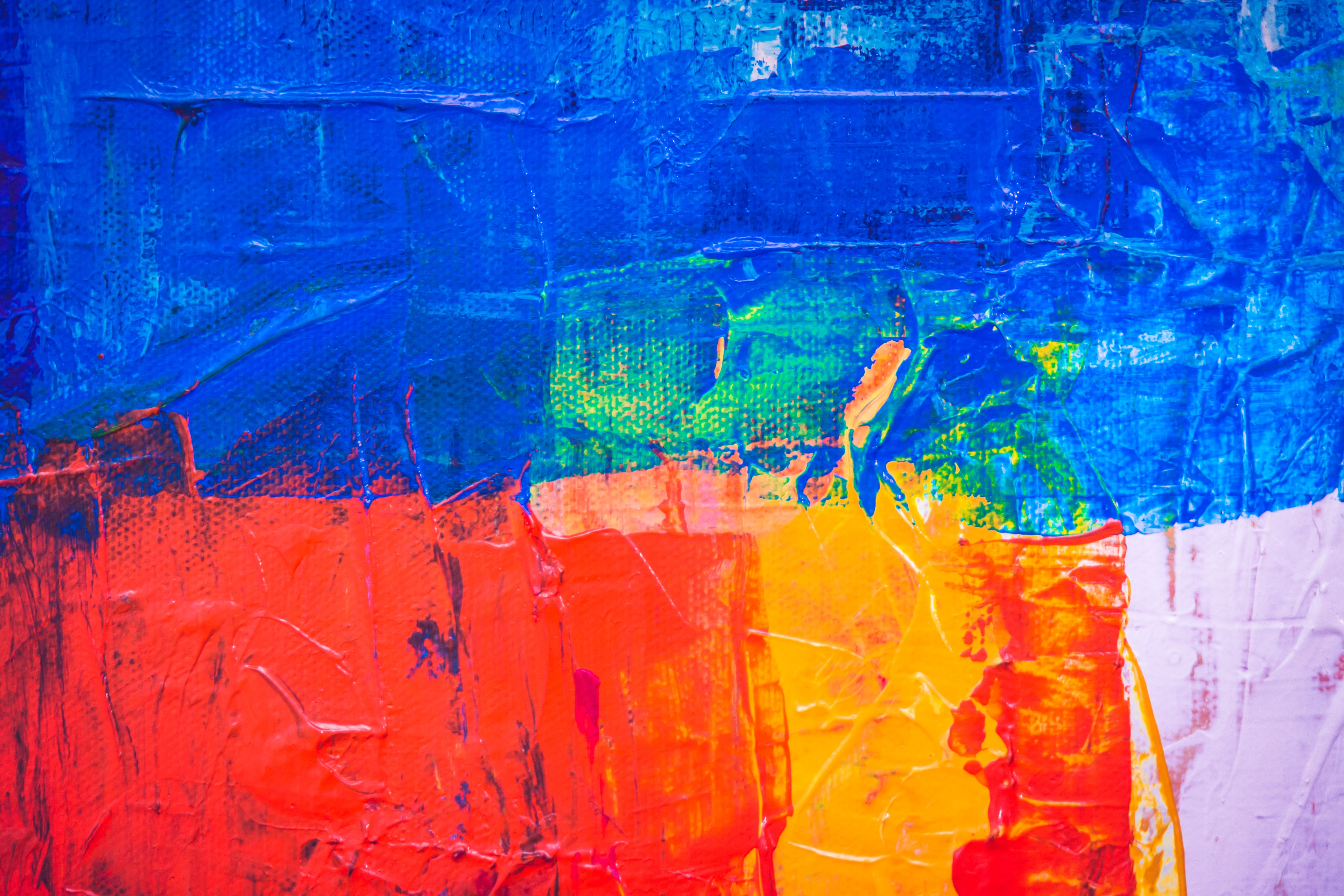 blue, red, pink, and yellow abstract painting