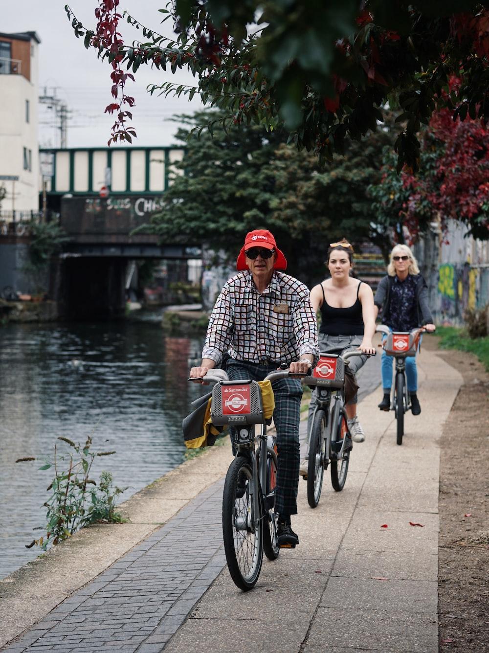 three people riding bicycle
