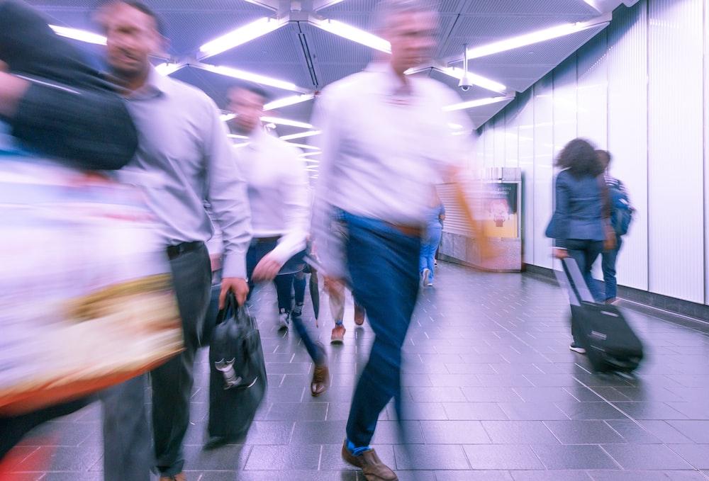people walking inside white hall