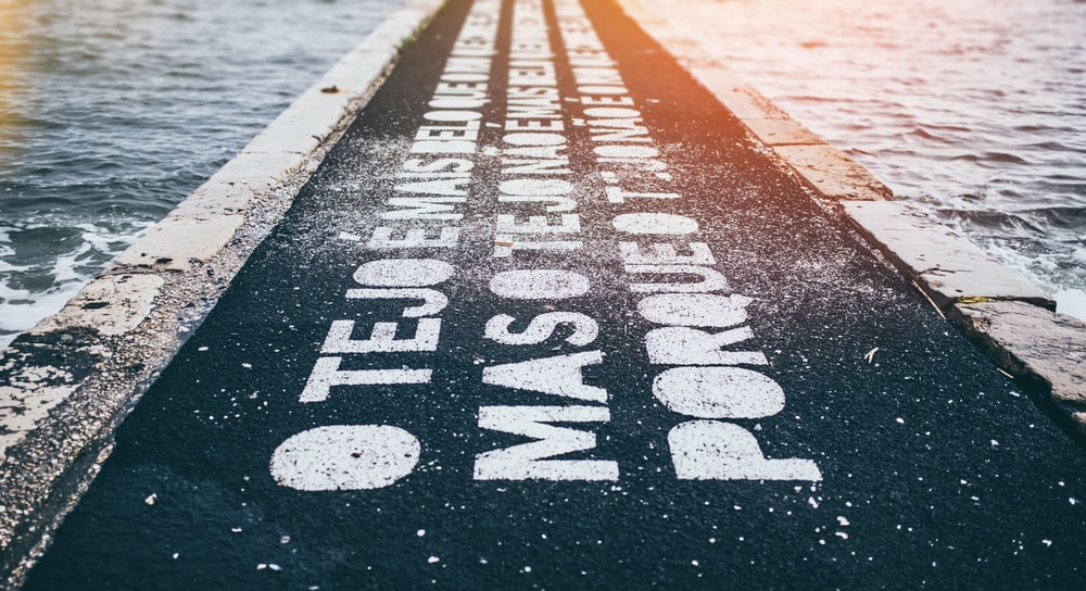 gray asphalt road with text