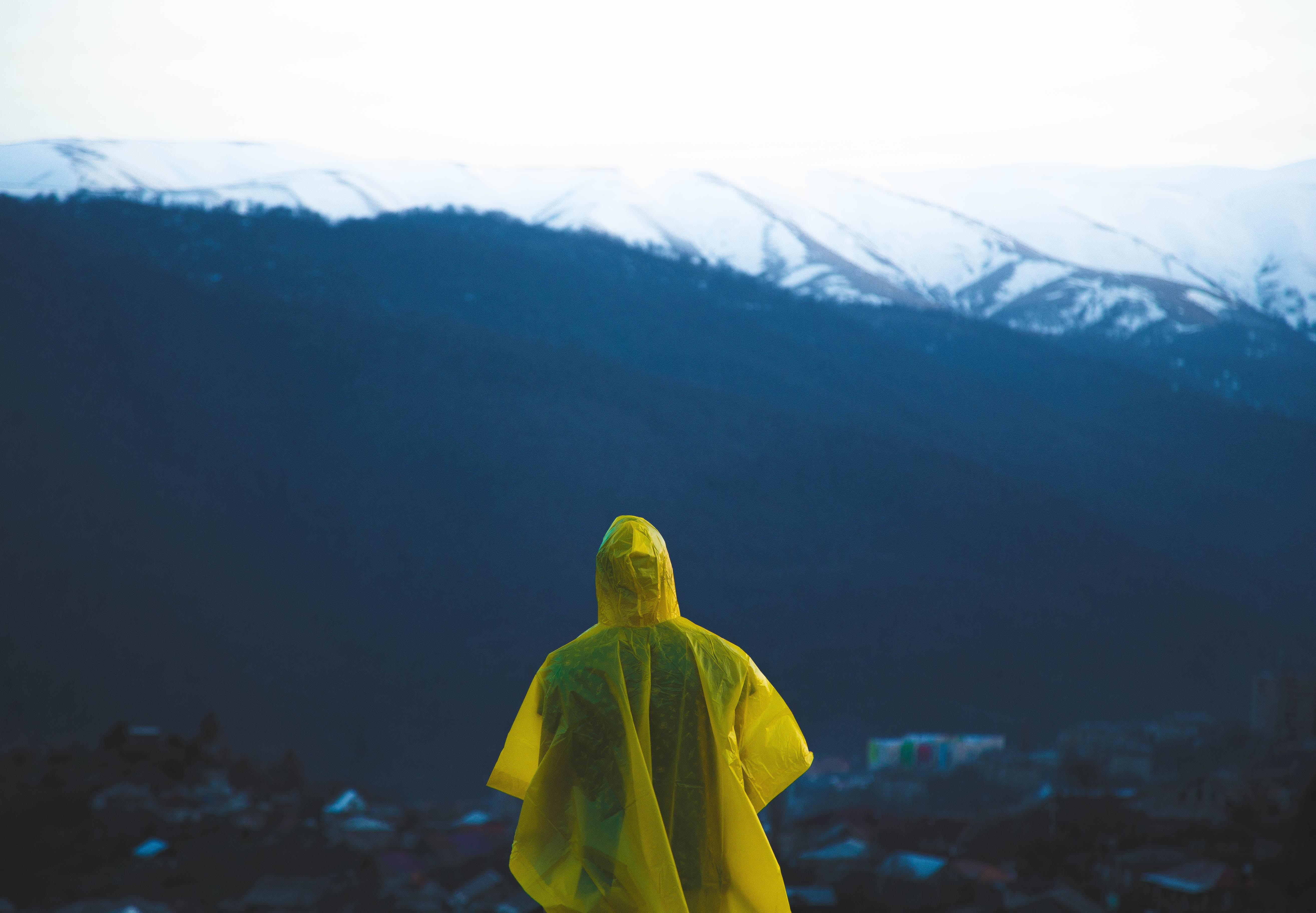 man wearing yellow rain coat