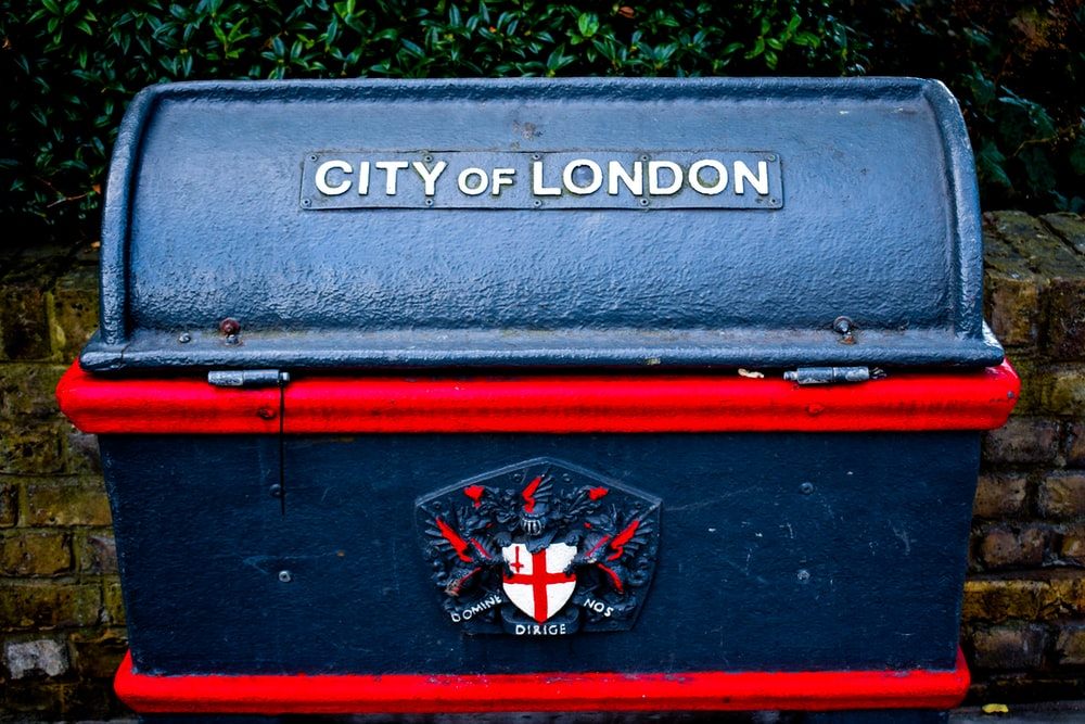 blue and red City of London-printed strongbox