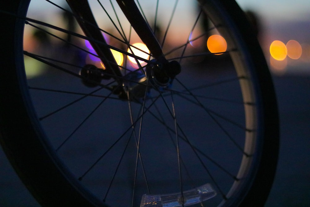 shallow focus photography of bicycle wheel