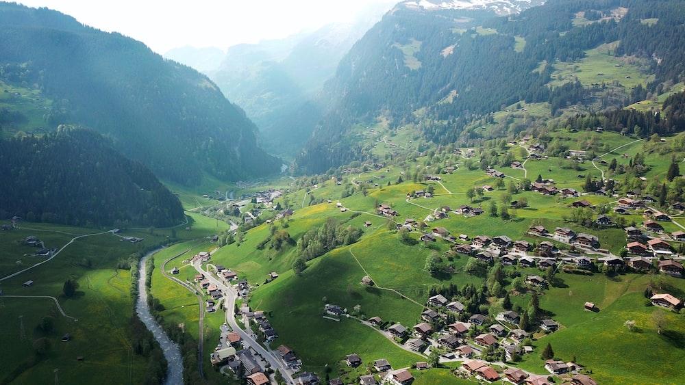 bird's eye view photography of village near mountain
