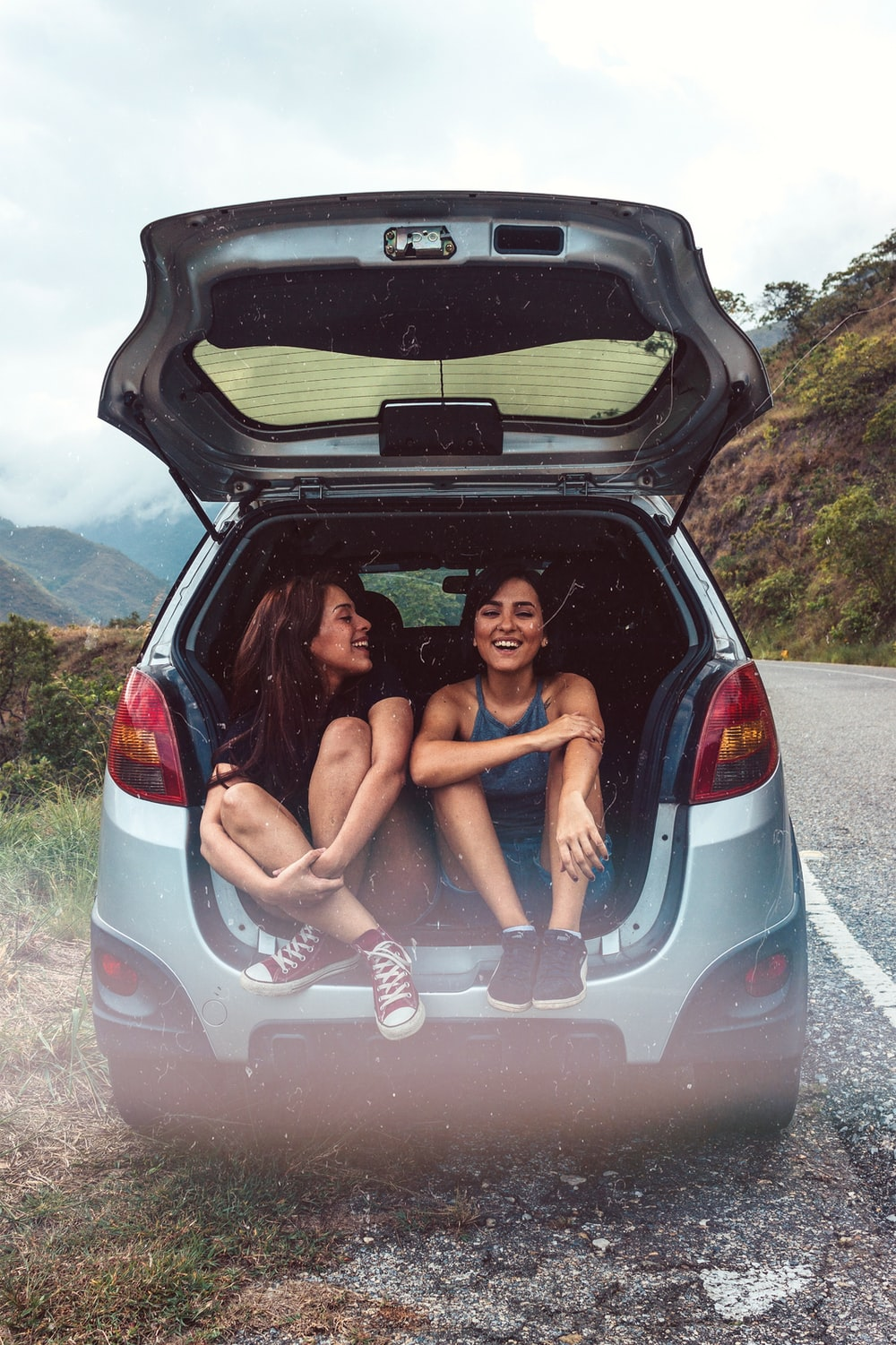 two women in hatchback compartment