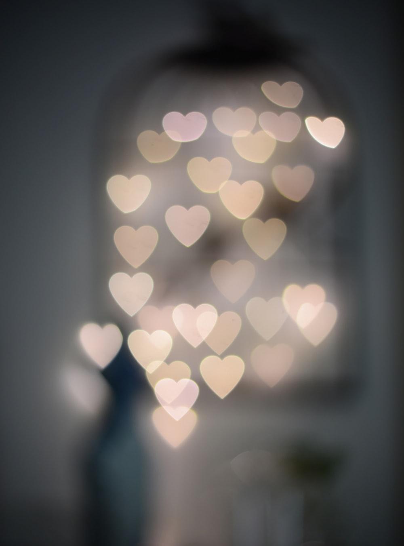 multiple blurry heart shaped lights