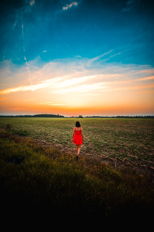woman walking in a grass field