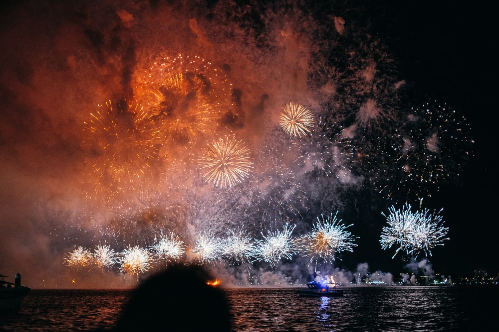 fireworks near body of water