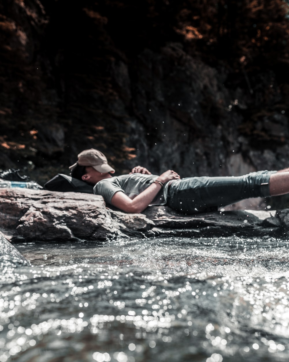 person sleeping on river