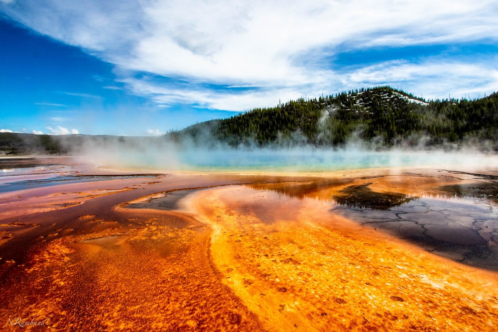 geyser within mountain range during daytime