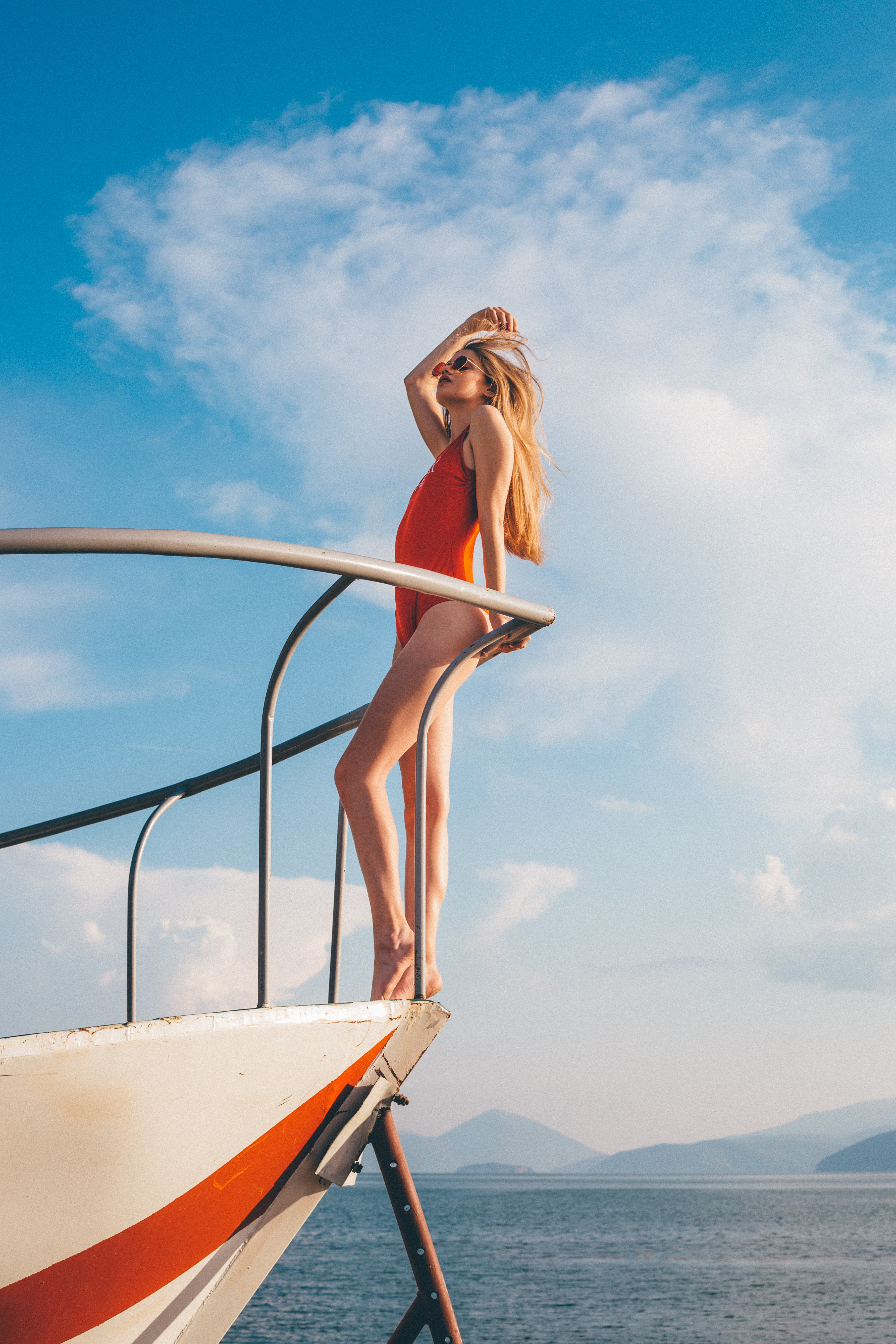 woman standing on white yacht