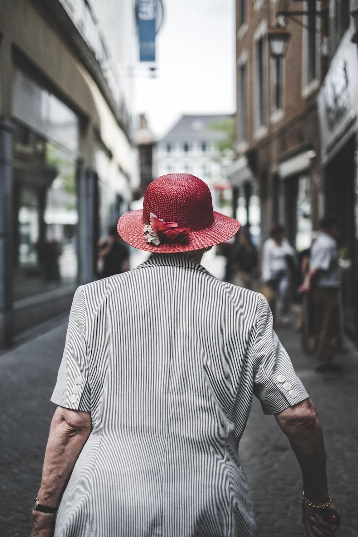 woman wearing red sun hat