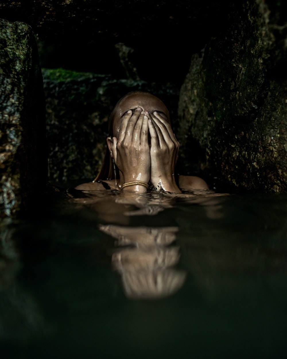 woman on water covering her face with both hands