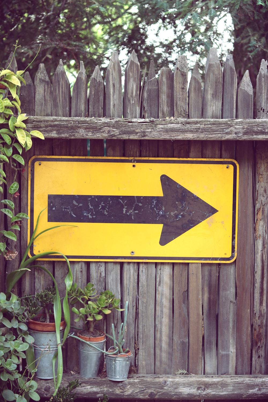 yellow arrow signage