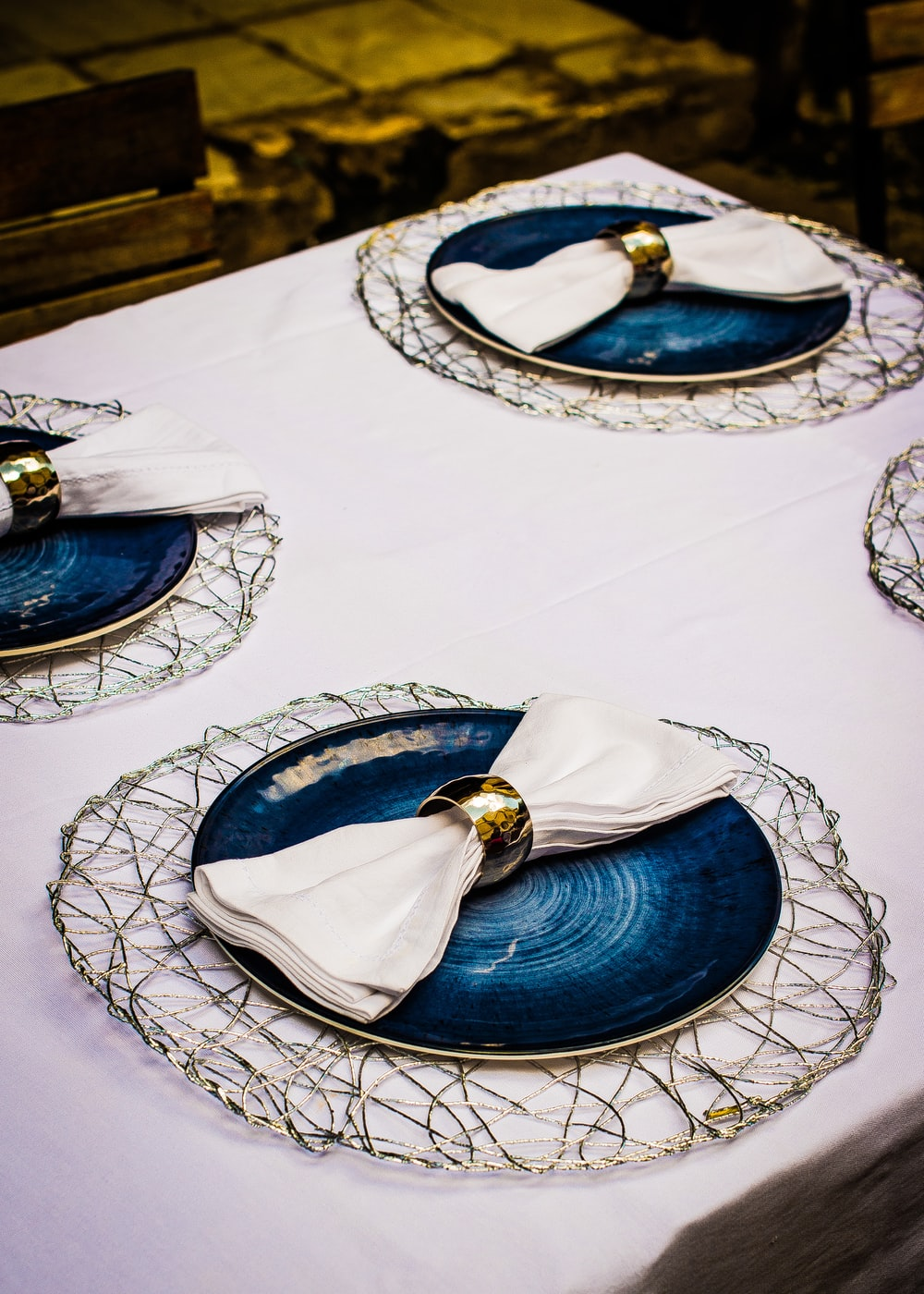 three round blue plate with clothes