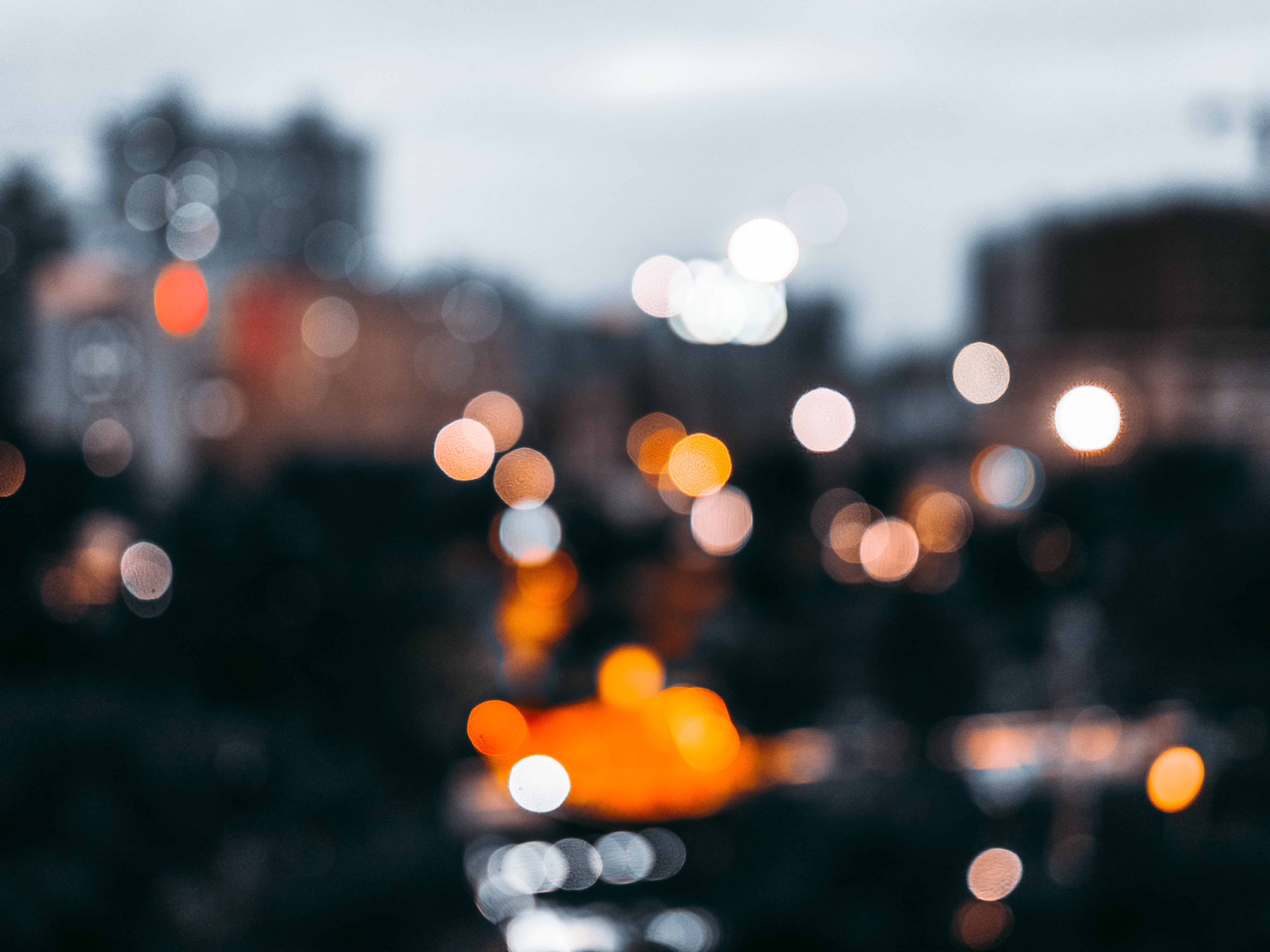 bokeh light photography of orange, white, and yellow lights