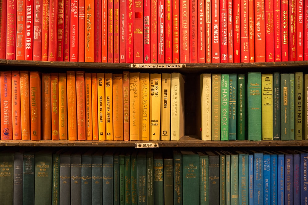 wooden bookcase filled with books