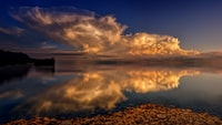 time lapse photography of body of water and cloud