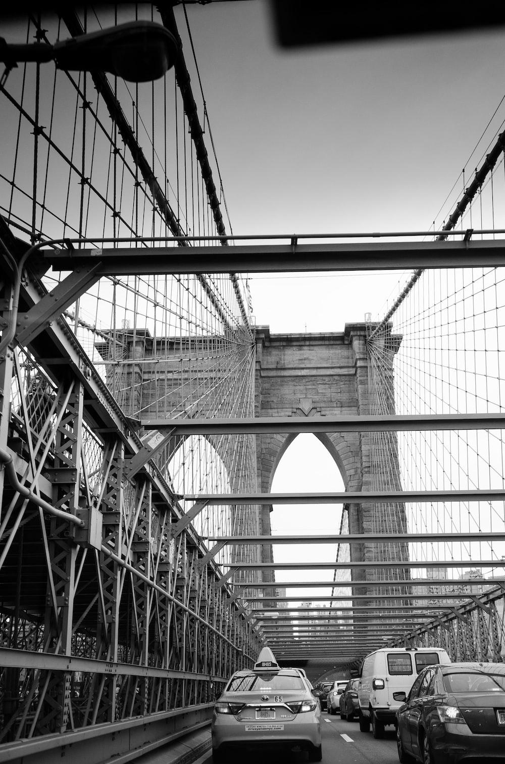 grayscale photography of concrete bridge