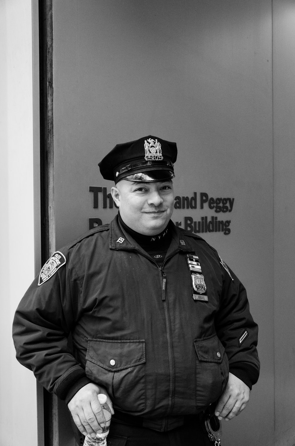 grayscale photography of police man