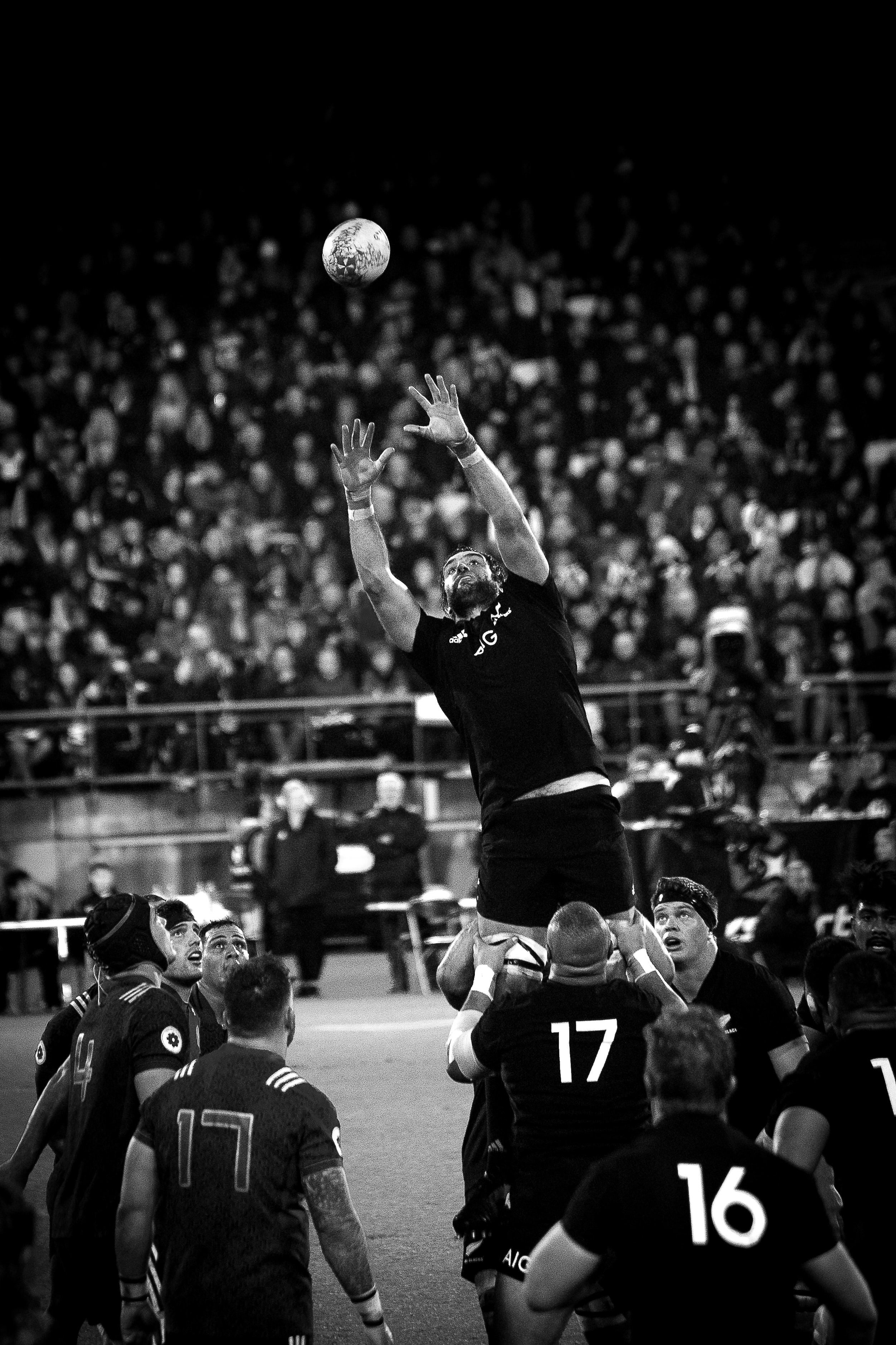grayscale photo of NFL player catching ball
