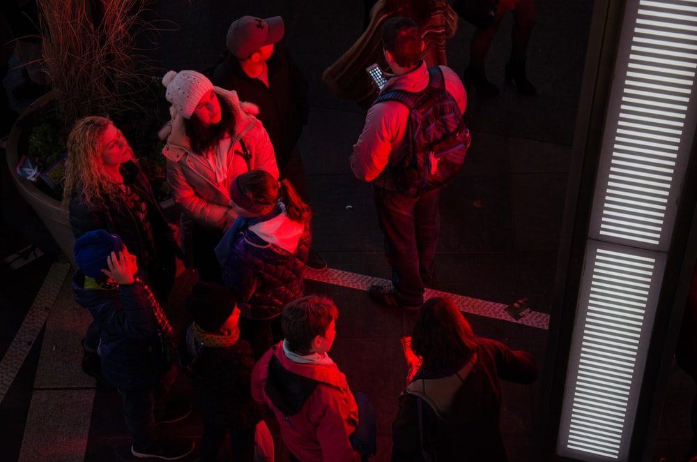 people gathering near red light