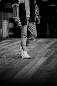 person walking on wooden plank board