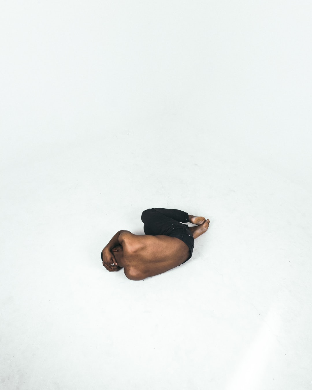 person lying down on white surface