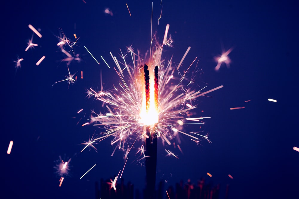 time-lapse photography of sparkler at night time