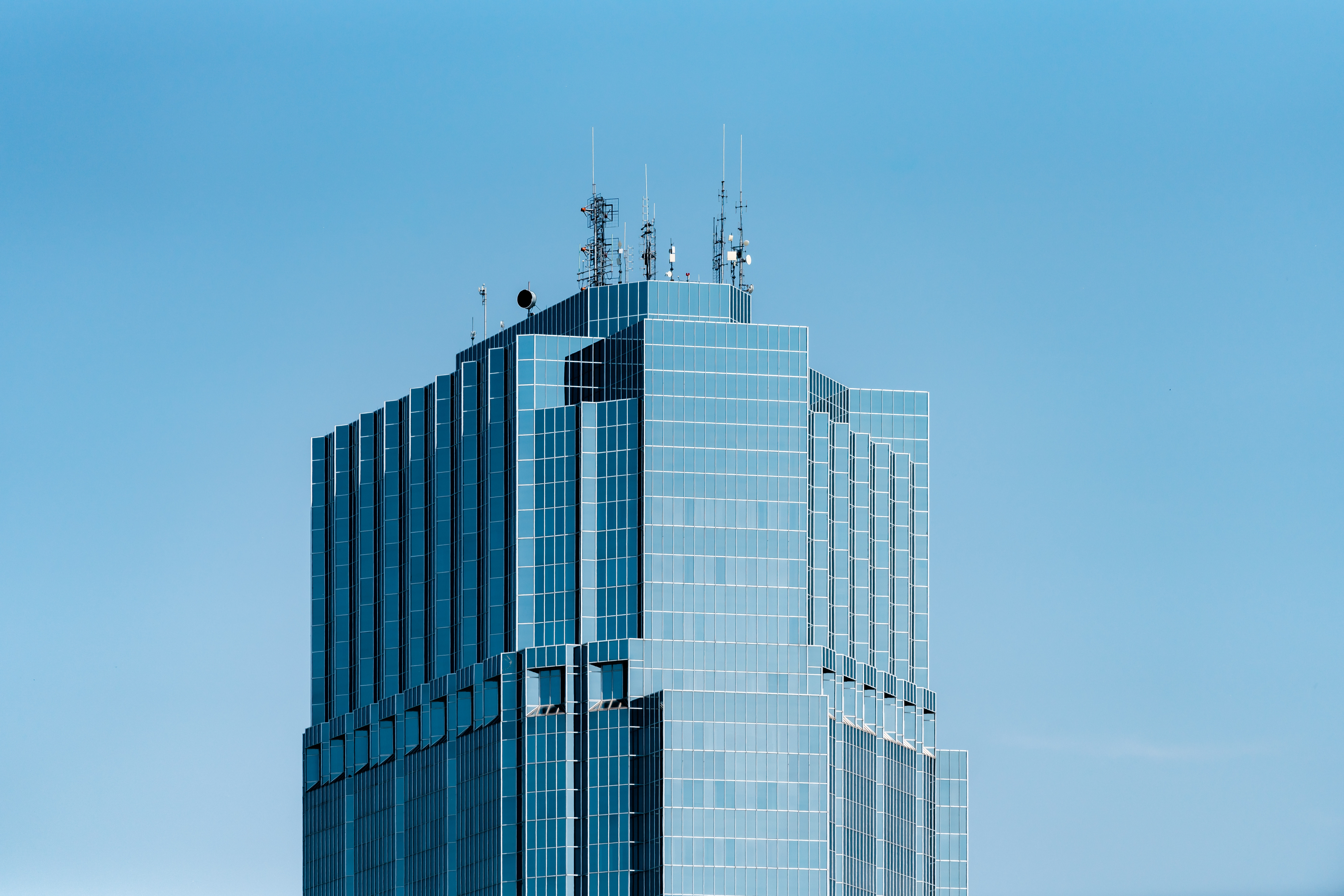 glass-mirrored high-rise building