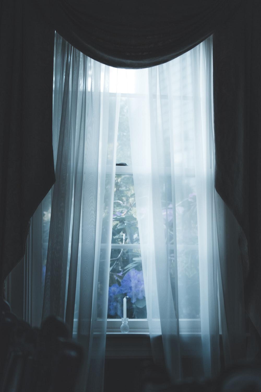 glass panel windowpane with white curtain