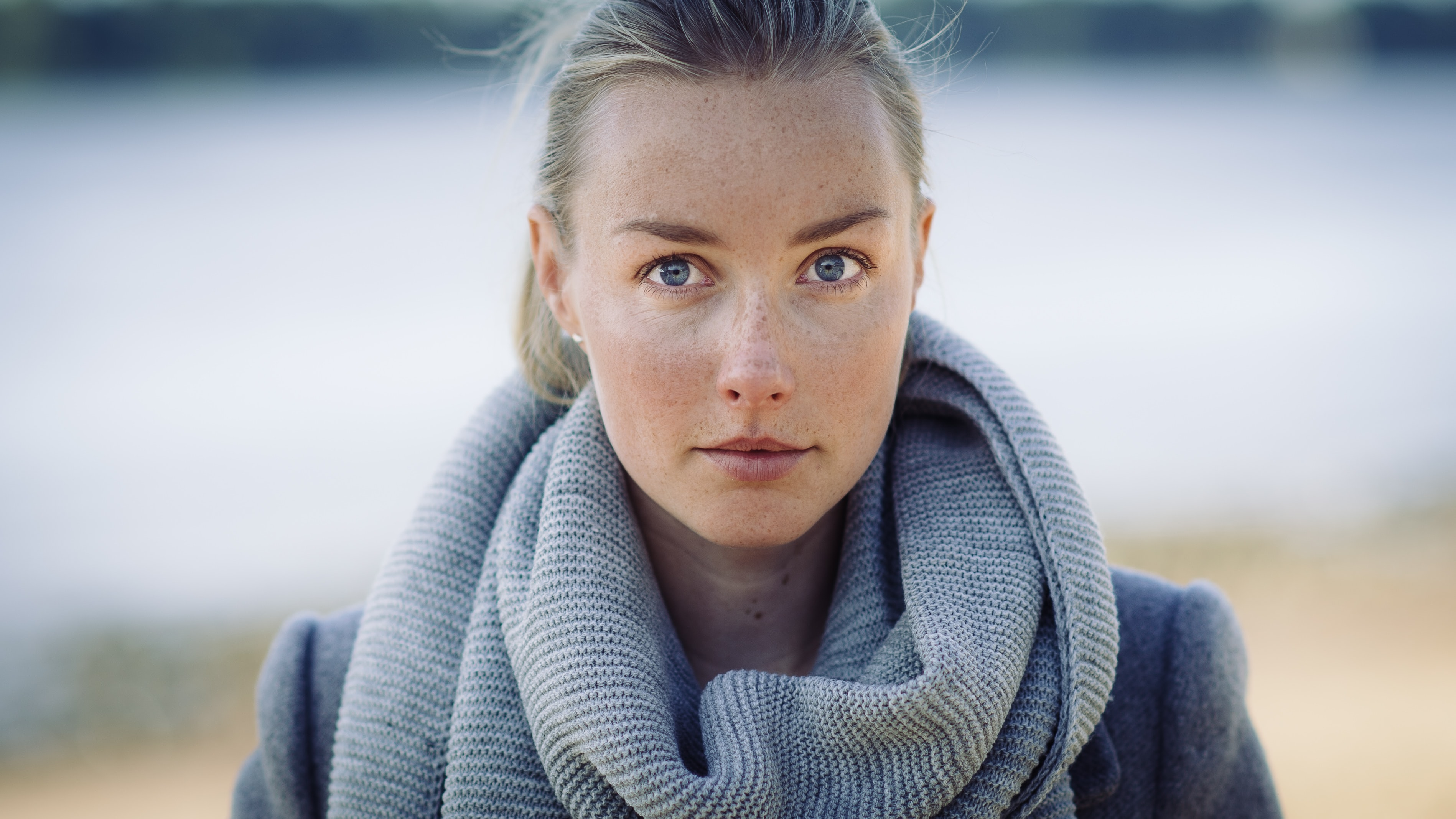 selective focus photo of woman wearing gray scarf
