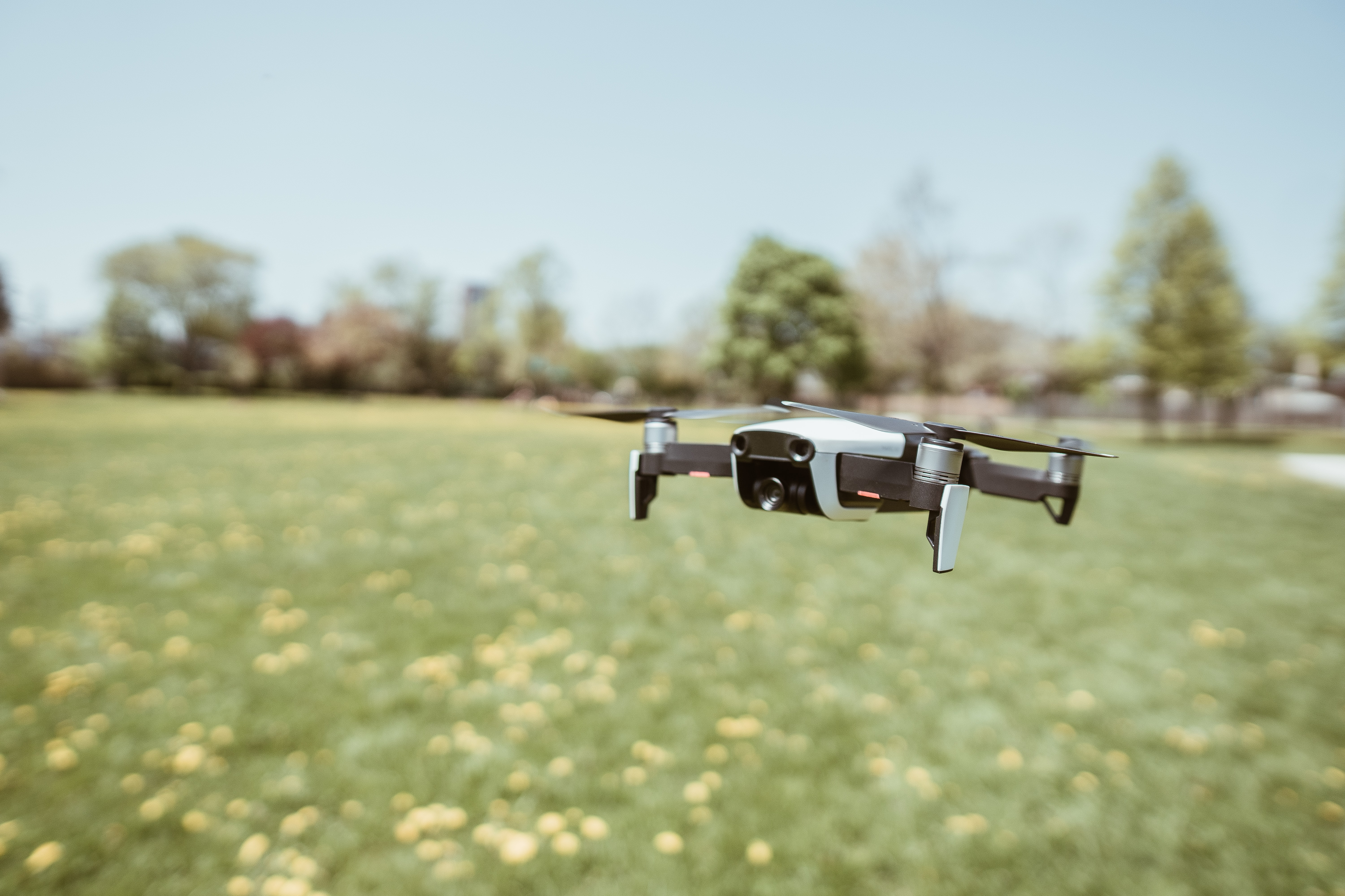 flying white and black drone