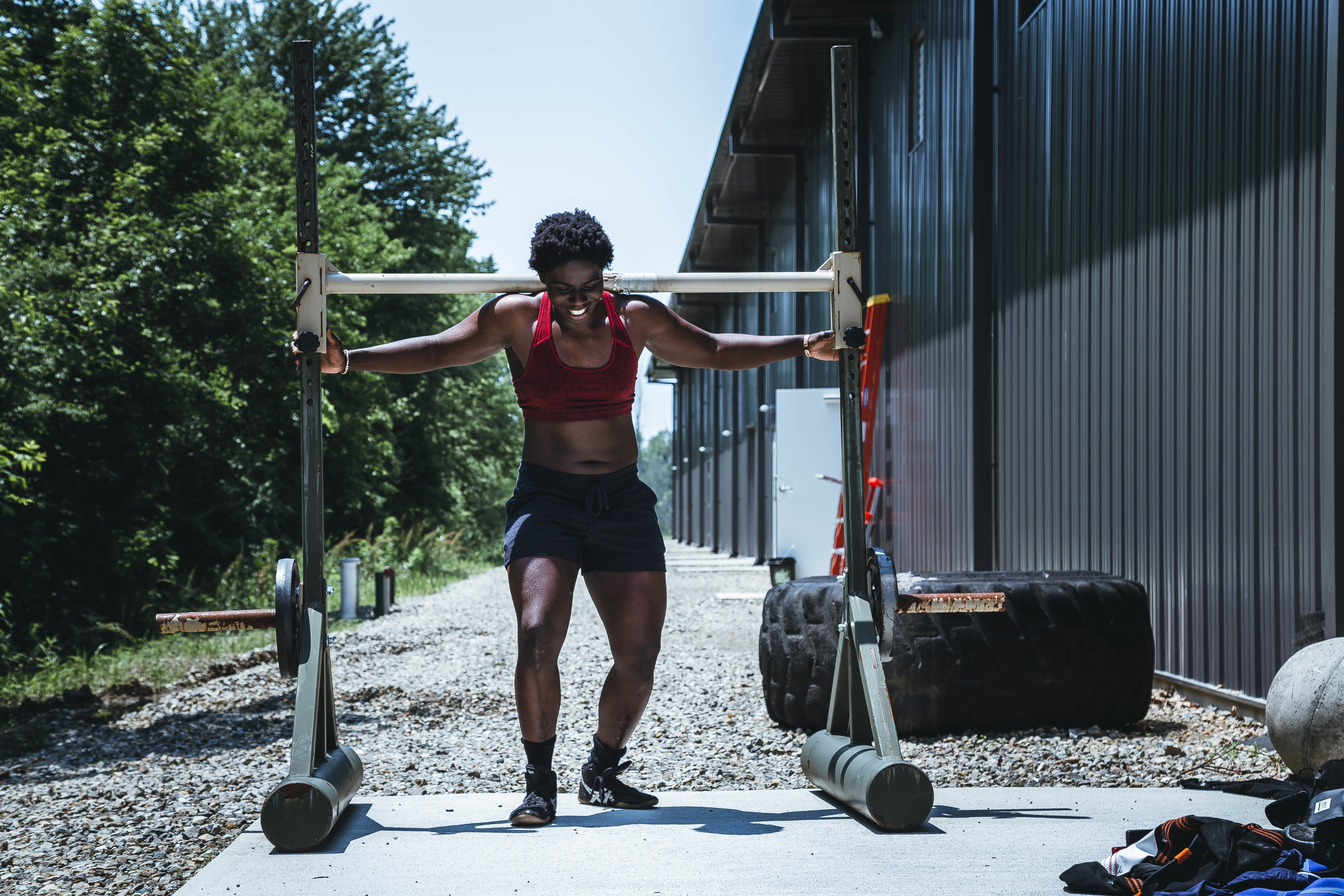 woman carrying white gym equipment at daytime