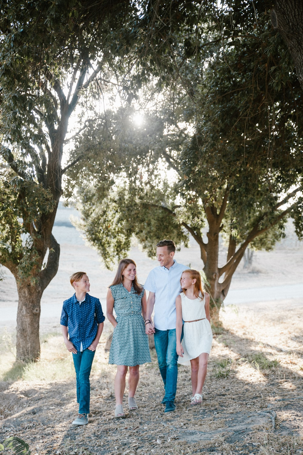 family standing in front of trees