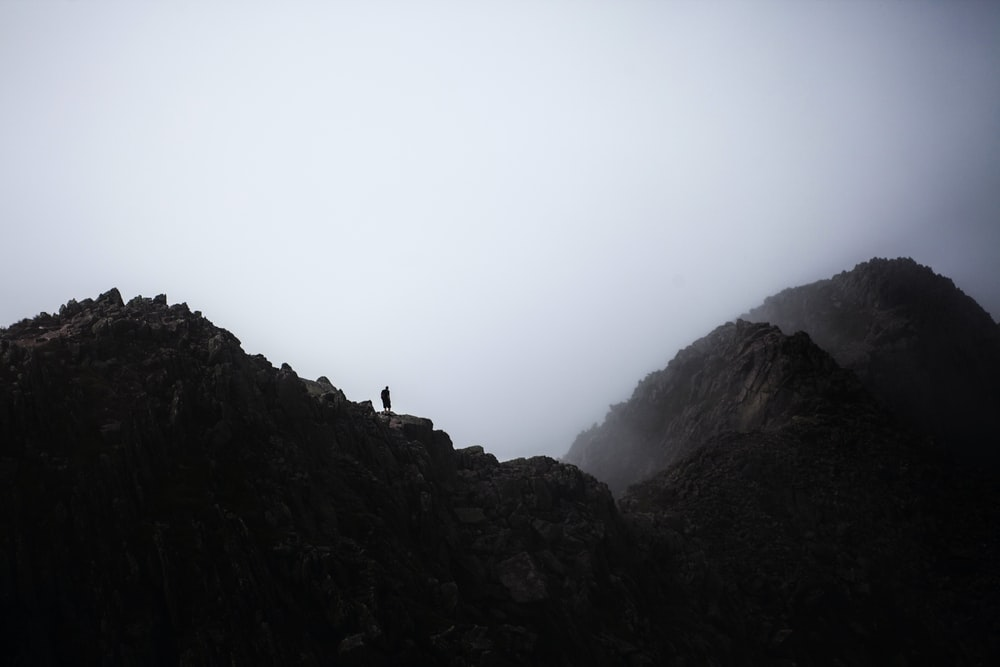 silhouette photography of person on cliff