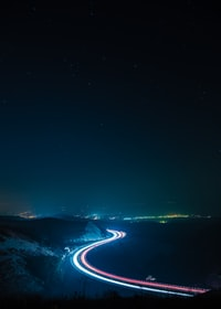 time-lapse photography of traveling cars