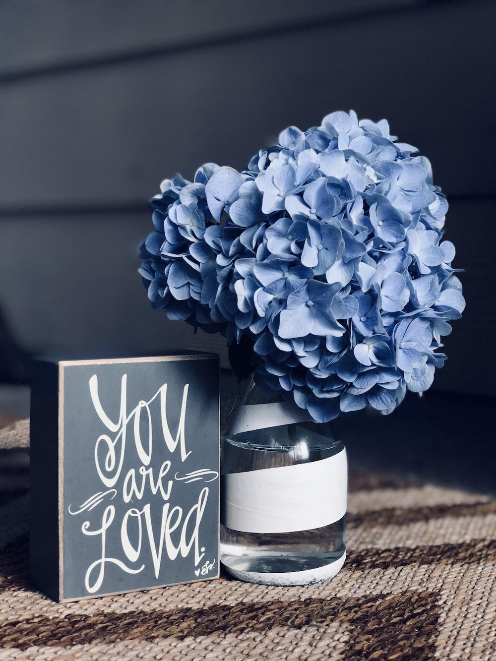 blue flowers in glass vase
