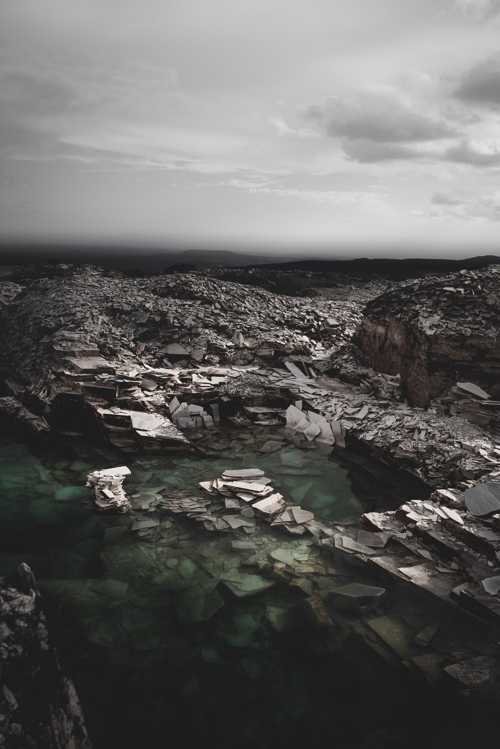 gray stones with body of water digital wallpaper