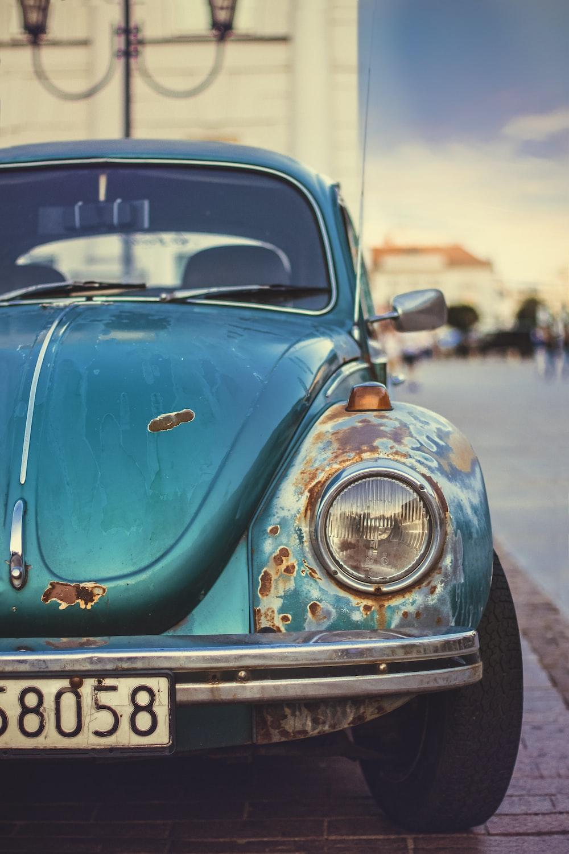 blue Volkswagen Beetle close-up photo