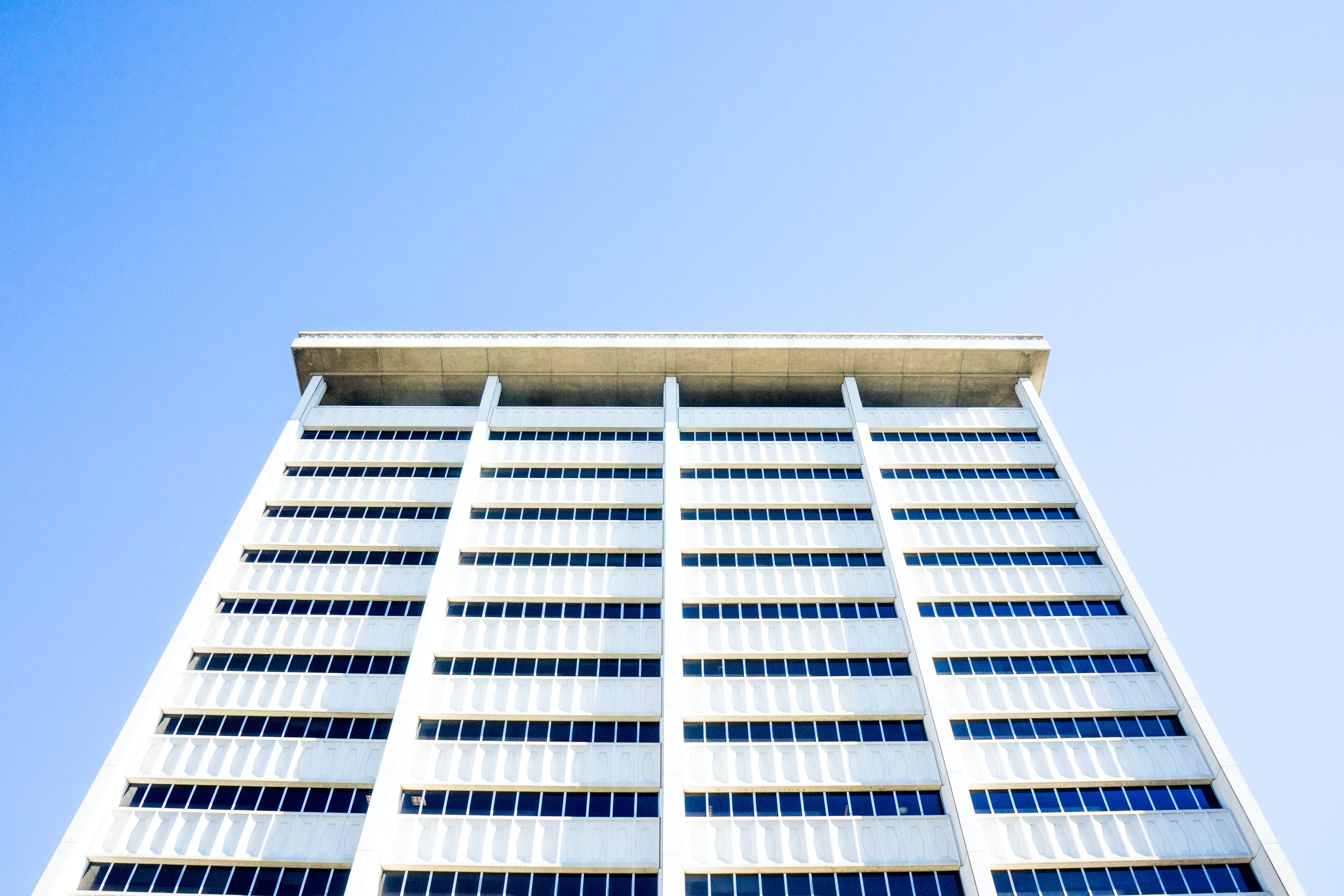 low angle photo of white high rise building