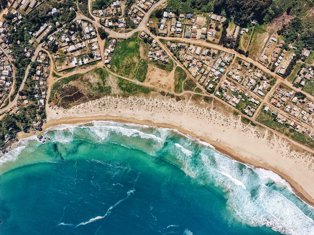high-angle photography of ocean and landscape