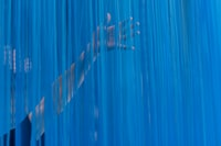 person touching blue curtain