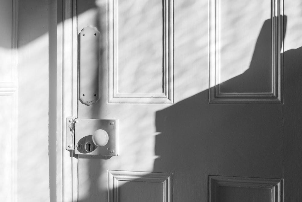 closeup photo of white door panel