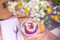 purple and white icing cake on white ramekin bowl